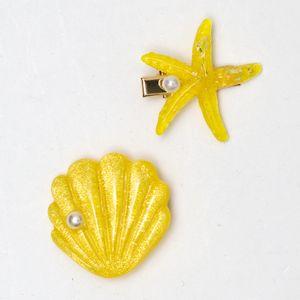 presilha-de-concha-e-estrela-do-mar-amarela