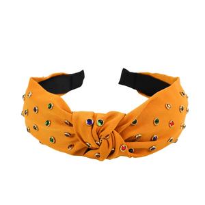 tiara-com-no-de-tecido-e-pedrinhas-coloridas-mostarda