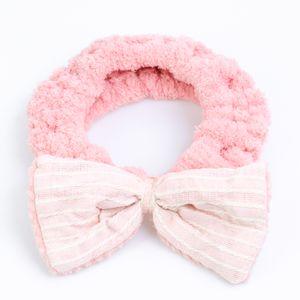 faixa-para-maquiagem-felpuda-lisa-com-laco-em-tecido-rosa